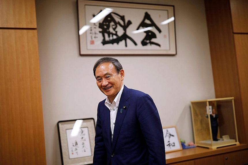 Japan's Chief Cabinet Secretary Yoshihide Suga (left) joins the race to take over from Prime Minister Shinzo Abe as president of the Liberal Democratic Party (LDP). The LDP president is virtually assured of being prime minister because of the party's