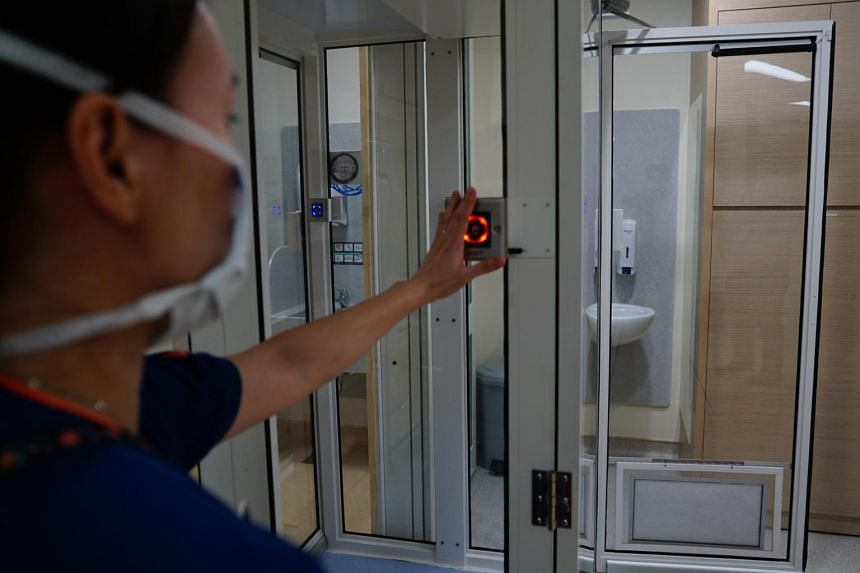 Dr Tan Zihui, associate consultant at SGH's department of anaesthesiology, entering a medical ICU fitted with the SG-Sparc system.