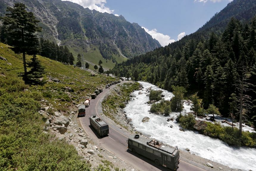 An Indian Army convoy moves along a highway leading to Ladakh, on June 18, 2020.