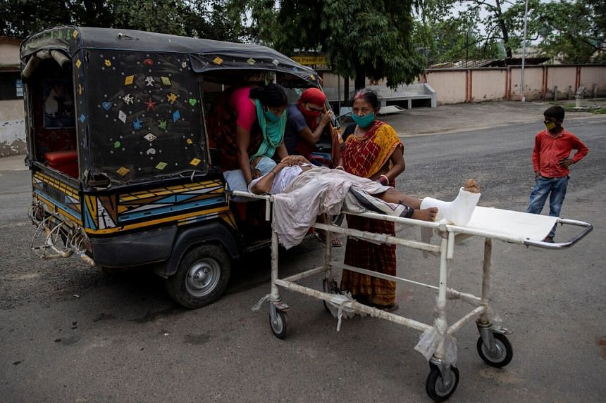 A patient being taken home on an auto-rickshaw after treatment at the Jawahar Lal Nehru Medical College and Hospital in Bhagalpur, Bihar.