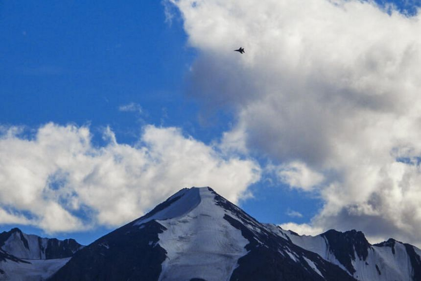 An Indian fighter jet flies over a mountain range in Leh, Ladakh, on Aug 31, 2020.