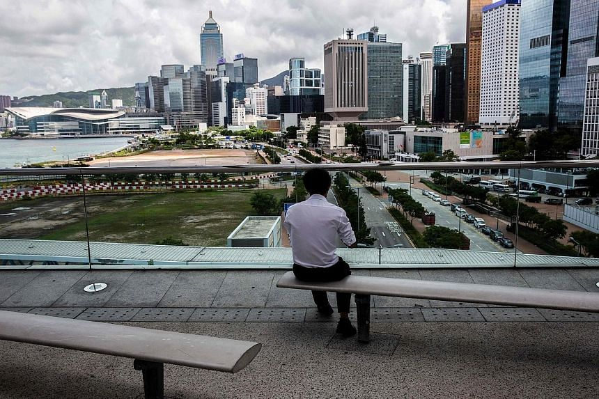 Commercial buildings in Hong Kong's Central district. Last month alone, Chinese buyers snapped up at least two office towers and one hotel building in Hong Kong worth HK$4 billion (S$702 million) in total, according to agents and filings.