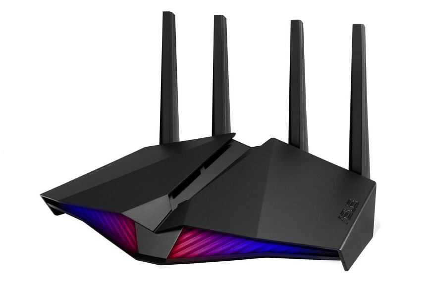 The Asus RT-AX82U has a fairly futuristic looking design with four upright, non-removable antennas.