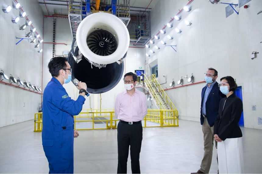 Trade and Industry Minister Chan Chun Sing (centre) and Minister of State for Manpower Gan Siow Huang (right) at the Singapore Aero Engine Services, on Sept 1, 2020.
