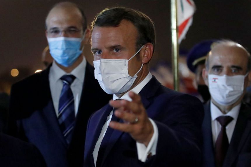 Macron gestures upon arrival at Beirut International airport on Aug 31, 2020.