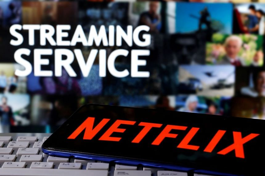A smartphone with the Netflix logo is seen on a keyboard in an illustration photo.