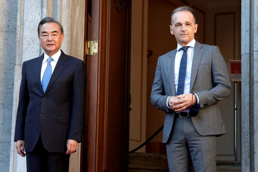 Maas (right) welcomes China's Foreign Minister Wang Yi before a meeting in Berlin, Sept 1, 2020.