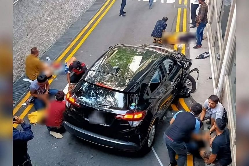 The car landed on a carpark exit lane a few metres below, killing two pedestrians and injuring four others who had been having a picnic by the railing.