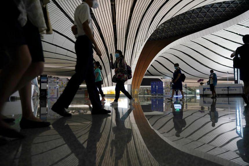 Passengers walking through Beijing Daxing International Airport on July 23, 2020.