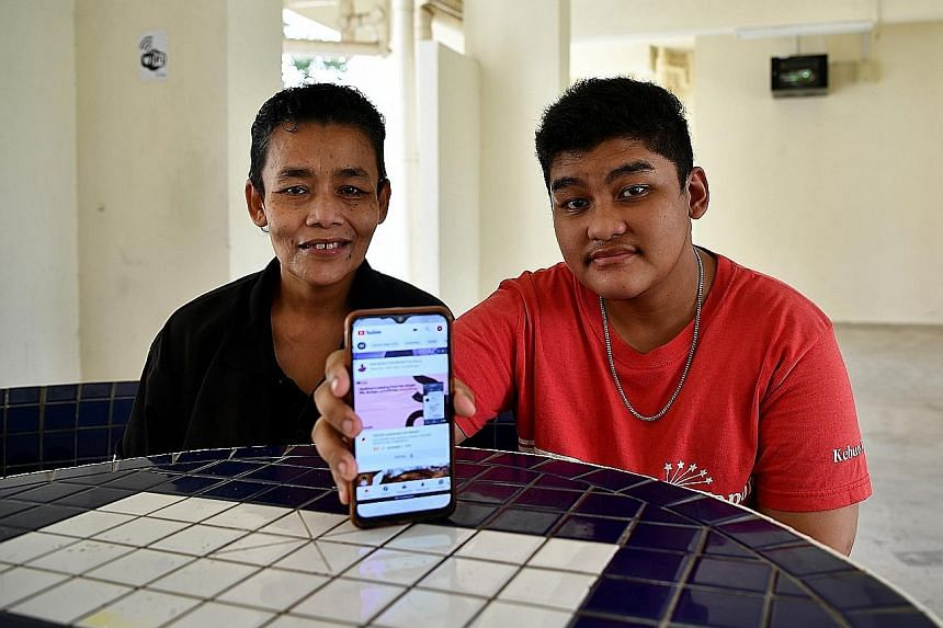 Madam Siti Aidah Abdullah and her son Mohamed Shazwan Mohamed Awal are among 300 homes in blocks 244 and 245 Ang Mo Kio Avenue 3 that can now tap free Internet access at the void deck of Block 245 with the installation of high-speed fibre broadband b