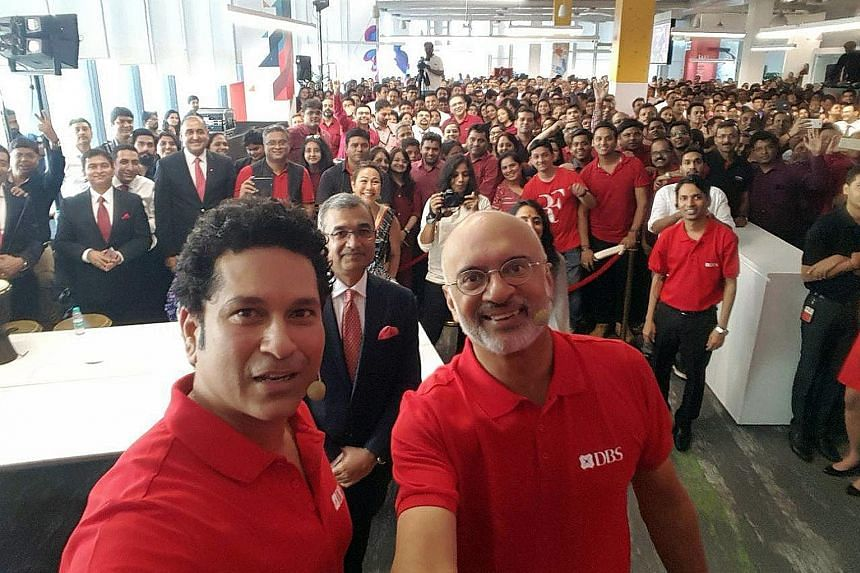 A 2017 wefie of DBS Bank chief executive Piyush Gupta (right, foreground) with employees in India, where the bank had opened a new office. Prime Minister Lee Hsien Loong noted how the photo was posted online to suggest that the bank was favouring for