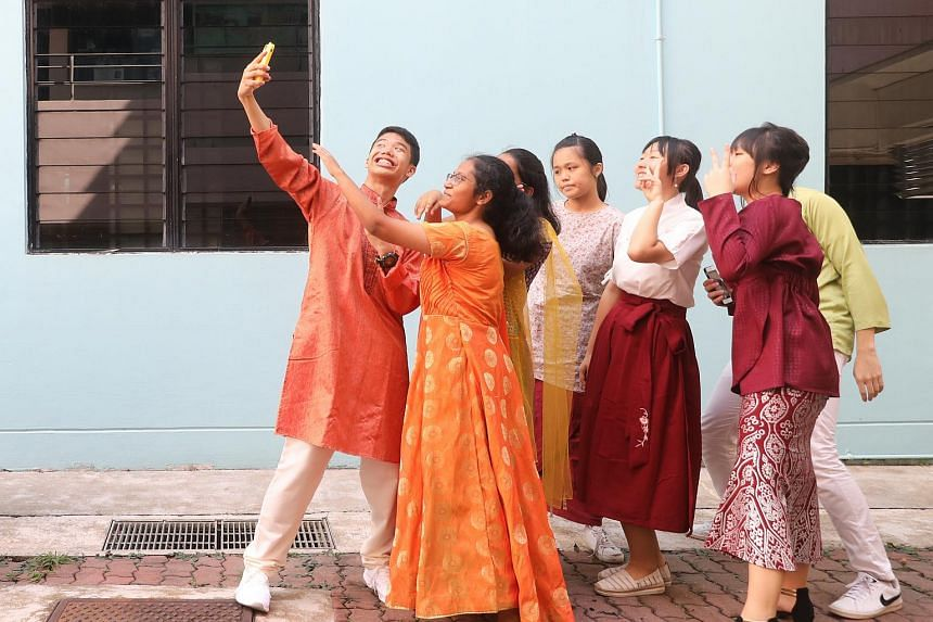 Students in ethnic costumes celebrating Racial Harmony Day at Chua Chu Kang Secondary School on July 17, 2019.