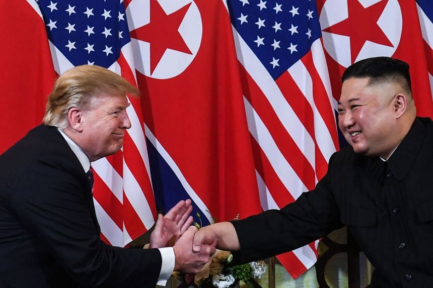 A February 2019 photo shows Trump (left) and Kim shaking hands in Hanoi, Vietnam.