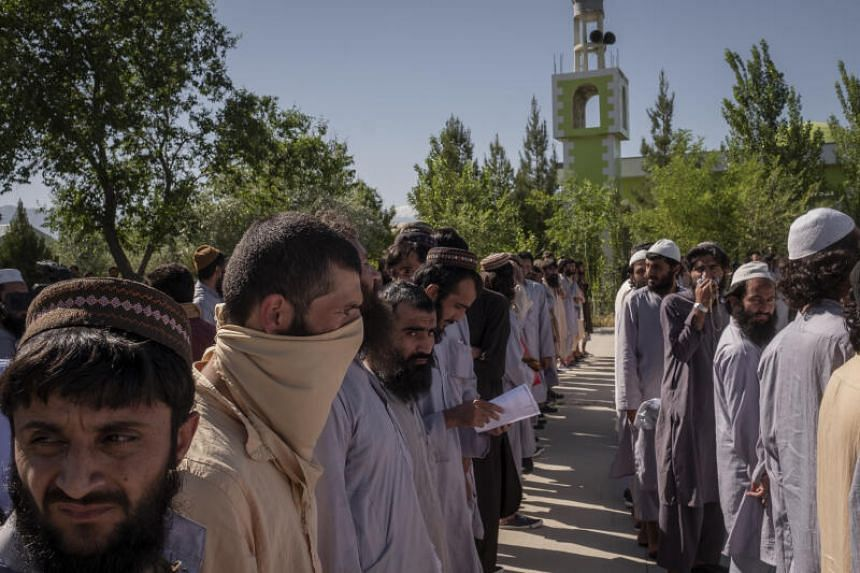 Taleban prisoners lined up at Bagram military base in Afghanistan, on May 26, 2020.