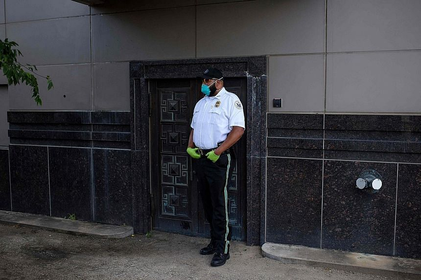 A United States law enforcement officer standing guard at a back door of the Chinese consulate in Houston in July, after the Trump administration ordered it to be closed. PHOTO: AGENCE FRANCE-PRESSE