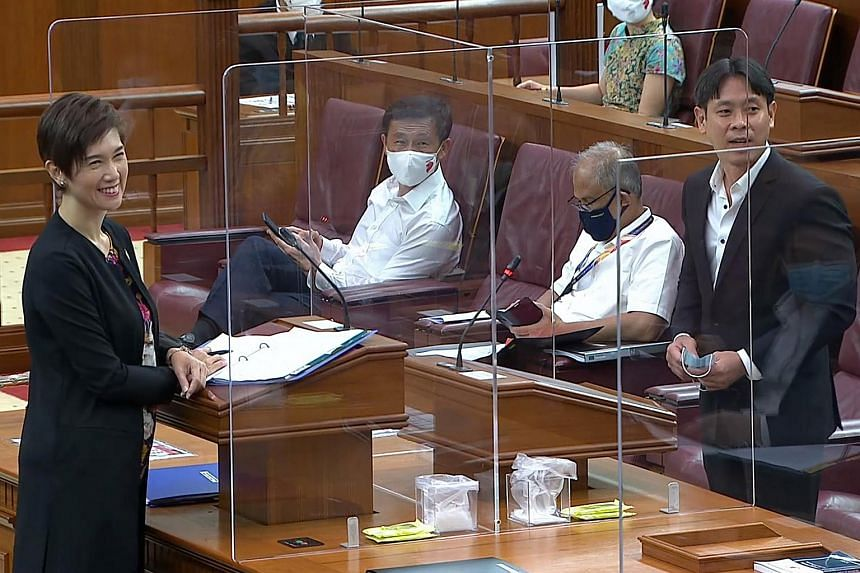 """Manpower Minister Josephine Teo and Nee Soon GRC MP Louis Ng responding to a quip by Speaker Tan Chuan-Jin about their """"intimate"""" conversation."""