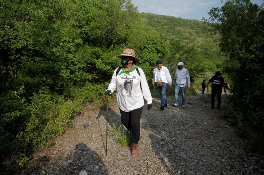 People with missing relatives and police officers take part in a search for skeletal remains and clothing in Hidalgo on Sept 3, 2020.