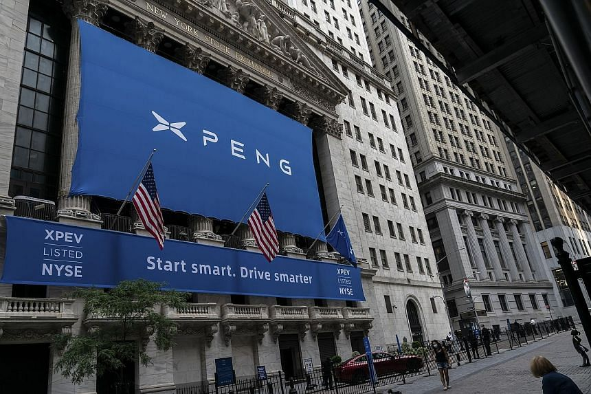 """An XPeng banner outside the New York Stock Exchange in New York on Aug 27. XPeng chose the NYSE because it offers the most """"sophisticated and deepest"""" capital markets in the world, which is important for new and growing industries, said company presi"""