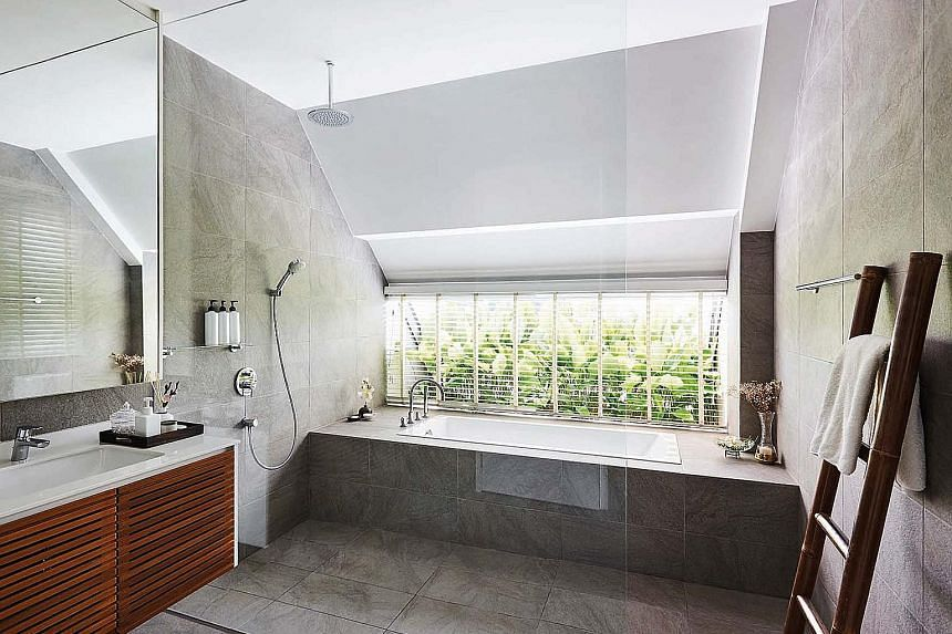 The master bathroom (above) comes across as spacious and well-ventilated, and opens out to an external planter.
