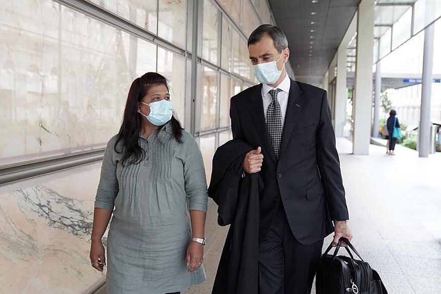 Miss Parti Liyani with her lawyer, Mr Anil Balchandani, outside the Supreme Court building yesterday. Her conviction on four theft charges was overturned.