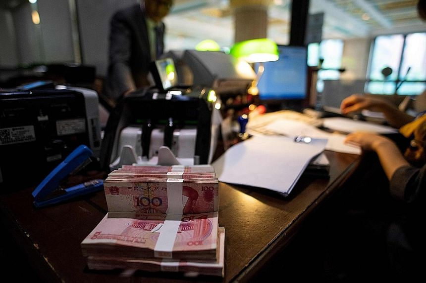 The Chinese currency's rally since this year's nadir in late May has made it one of the best performers in Asia, with the buying momentum still standing close to the strongest since January. PHOTO: AGENCE FRANCE-PRESSE