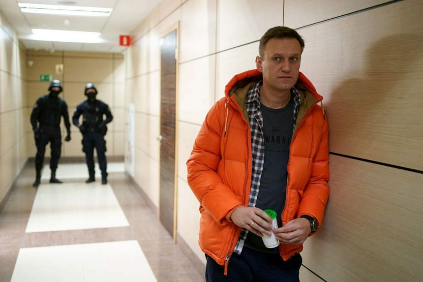 A December 2019 photo shows Navalny standing in a hallway of a business centre housing his Anti-Corruption Foundation in Moscow.