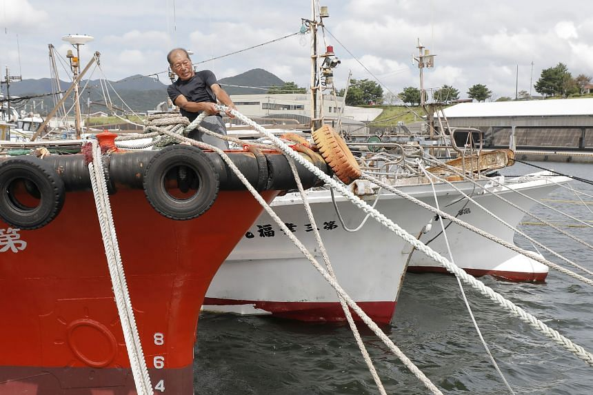 A fisherman ties a boat as a preparations are made for approaching Typhoon Haishen in Makurazaki, Japan, on Sept 5, 2020.