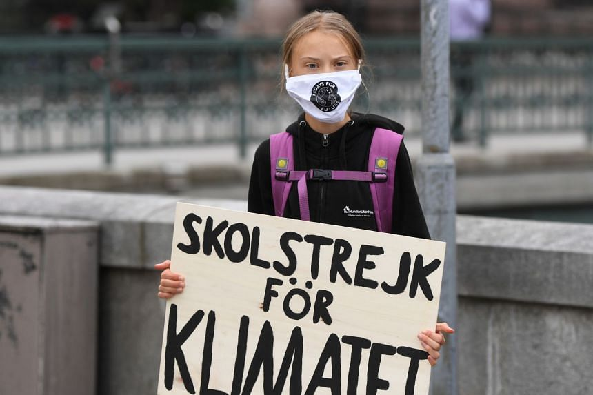 Greta Thunberg holds a poster reading 'School strike for climate' as she protests in front of the Swedish parliament on Sept 4, 2020.