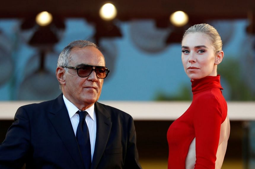 Director of the festival Alberto Barbera and actress Vanessa Kirby pose on the red carpet, Sept 5, 2020.