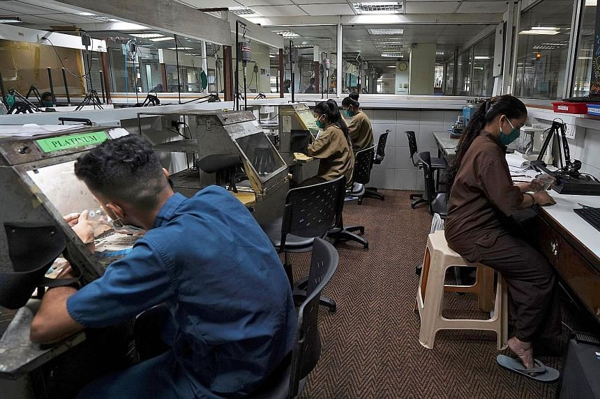 Employees at a diamond jewellery manufacturing factory in Mumbai last month. India's economy contracted 23.9 per cent in the April to June quarter - the highest contraction since India began keeping quarterly records in 1996, and many experts fear pr