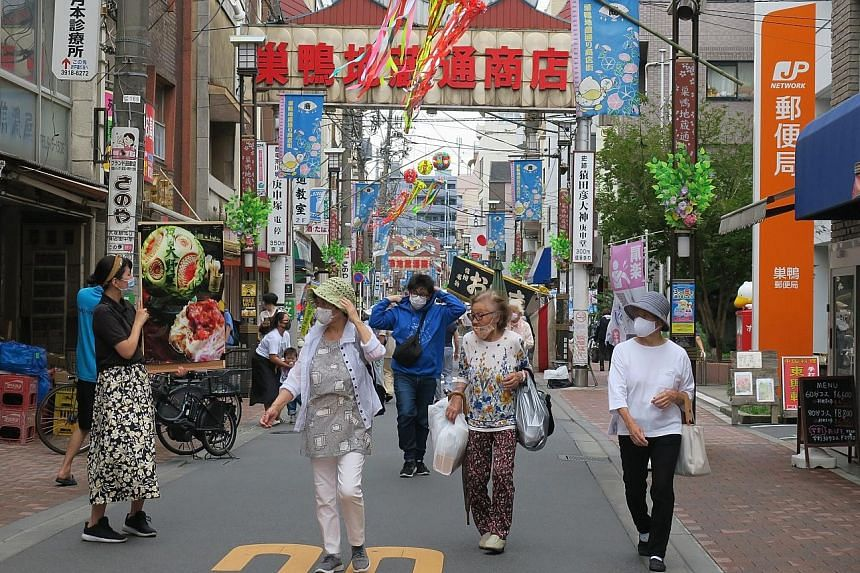 A relatively empty Sugamo Jizodori Shopping Street in Tokyo on a festival day. Sugamo is struggling to replicate its heady past in the late 1980s and 1990s, when as many as 100,000 people would throng it on festival days. Now, about 15,000 people vis