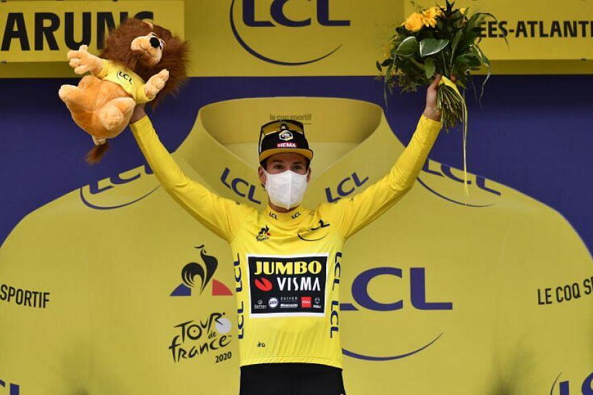 Slovenian rider Primoz Roglic of Team Jumbo-Visma celebrates on the podium on Sept 6, 2020.