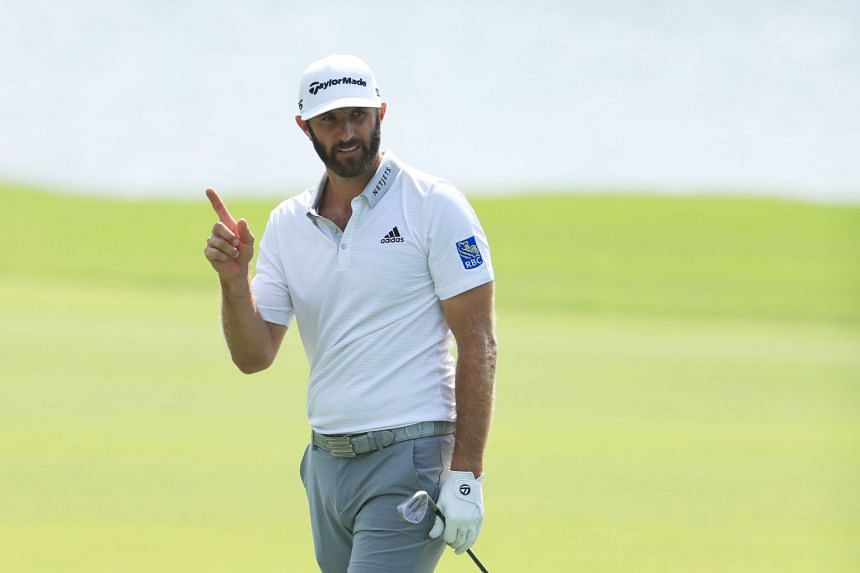 Johnson reacts after chipping in on the eighth hole during the second round.