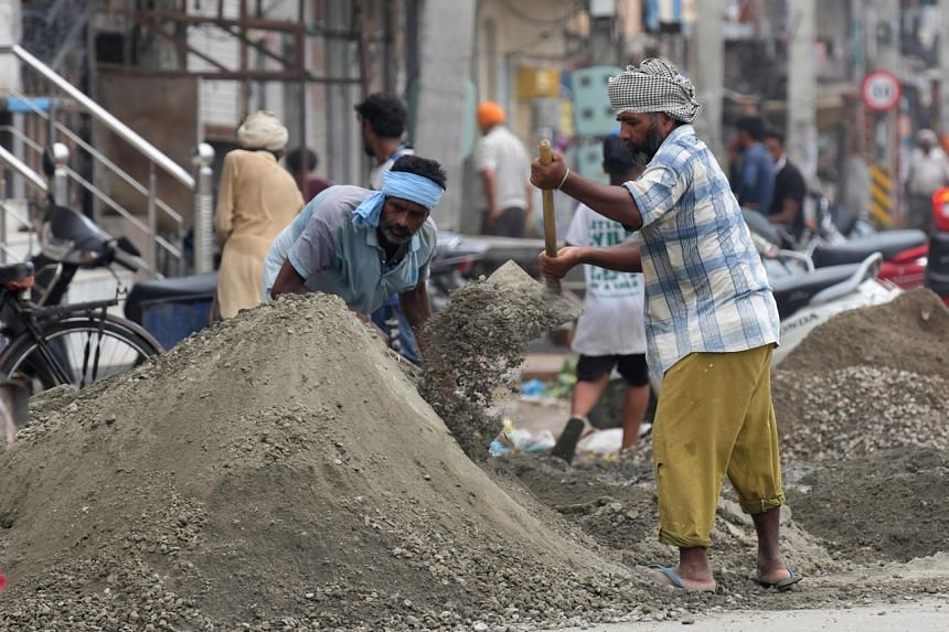 Labourers work at a construction site on the outskirts of Amritsar, India, on Sept 5, 2020.