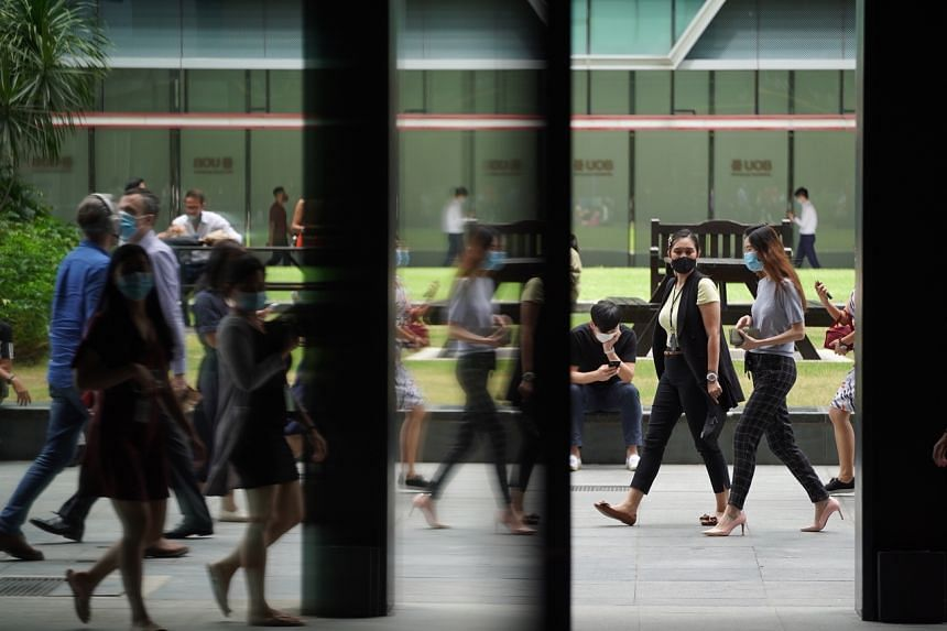 Office workers at Raffles Place on Aug 31, 2020.