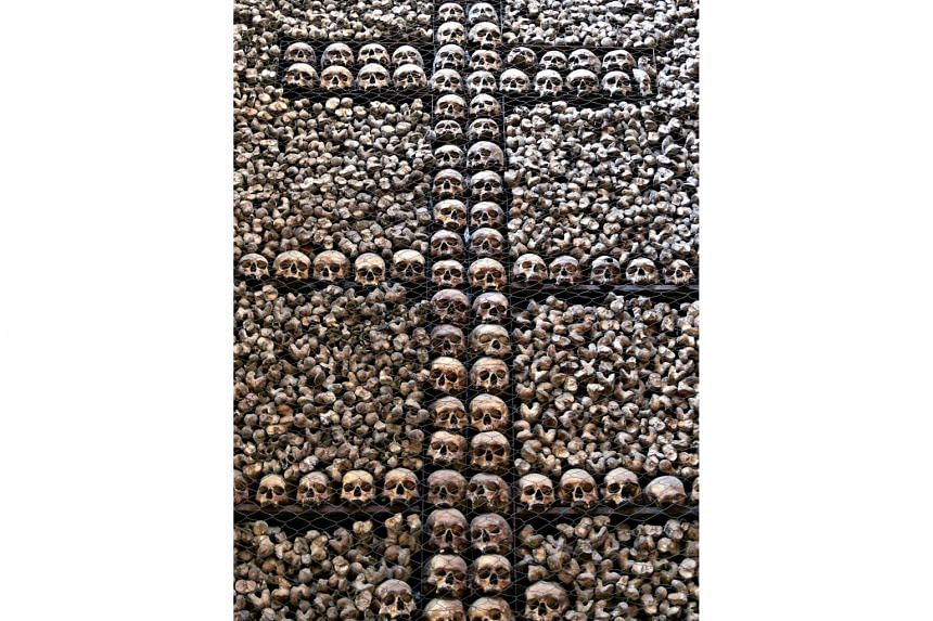 Milan's San Bernardino alle Ossa church boasts a splendid interior with a storied past. Inside the church is a room with a wall of human skulls and bones (above), some of which are believed to be those of plague victims.
