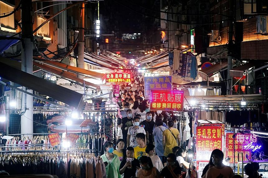 A street market in Wuhan teeming with people last week. No new local Covid-19 transmissions have been reported in the Chinese city for months and life has returned to normal.