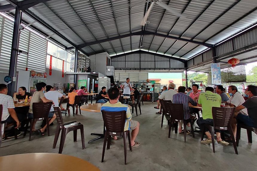 Above: Save Musang King Alliance chairman Chang Yee Chin briefing durian farmers at a coffee shop in Sungai Klau last Thursday. Left: While most of the farmers are Chinese, there are also over 100 Malay families who work these lands. They include far