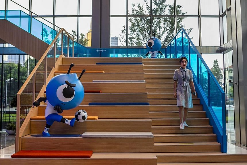 A staff member in the Alipay and Ant Group headquarters in Shanghai last week. The initial public offering of financial technology company Ant - as soon as next month - would be the first simultaneous listing in Hong Kong and on Shanghai's Star Marke
