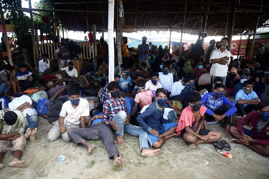 Rohingya migrants look on following their arrival by boat in Aceh on Sept 7 2020