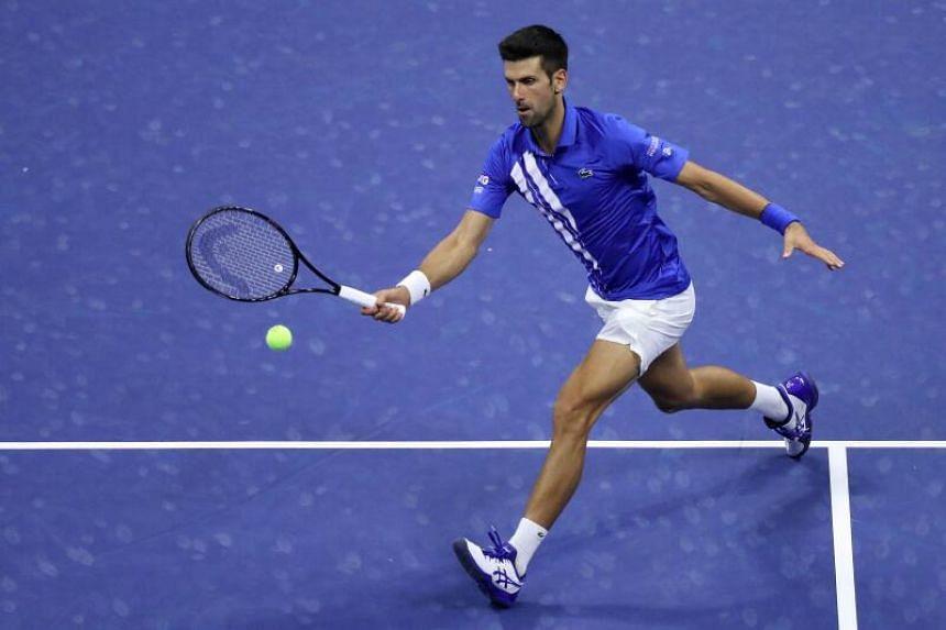 Novak Djokovic of Serbia returns a volley.