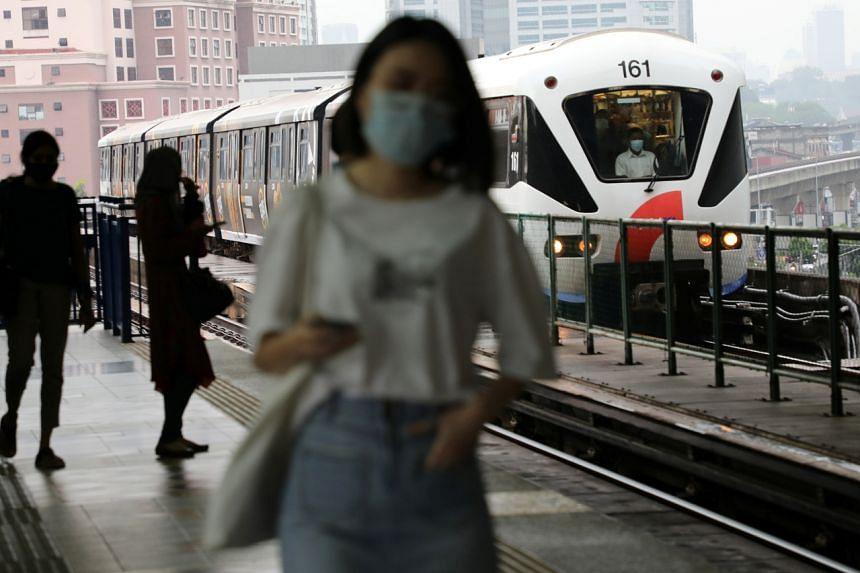 A Light Rail Transit train arrives at a station in Kuala Lumpur on July 27, 2020.