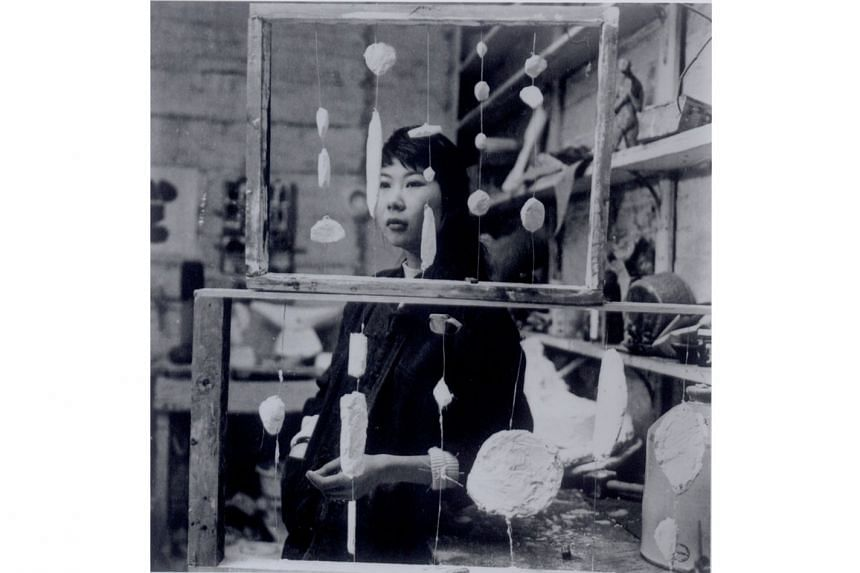 Born in Singapore in 1936, artist Kim Lim (above, in her studio with the 1959 work, Abacus) was both a sculptor and printmaker.