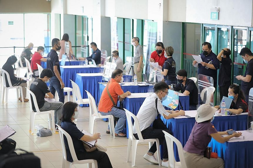 People at a job fair held by the National Trades Union Congress' Employment and Employability Institute at Chong Pang Community Club last month. Retrenchments more than doubled in the second quarter of this year, with 6,700 workers laid off, up from