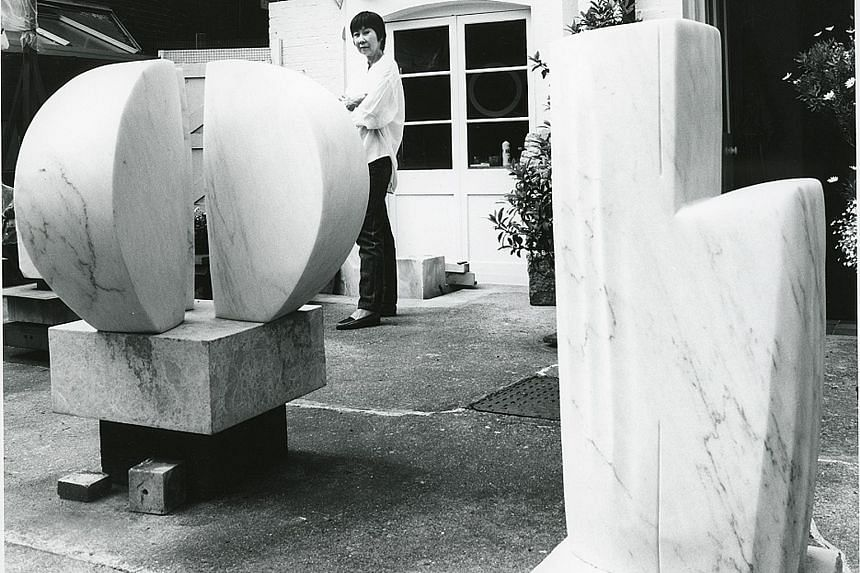 Lim's Sphinx sculpture (1959, above) will be among the works on display in the exhibition, Kim Lim: Carving And Printing, at Tate Britain (top). Born in Singapore in 1936, artist Kim Lim (above, in her studio with the 1959 work, Abacus) was both a sc