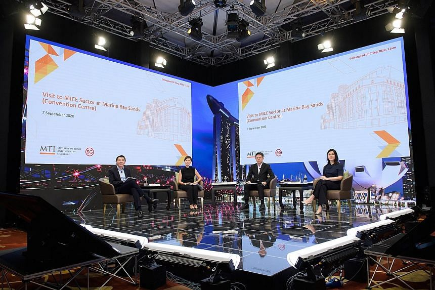 (From left) Changi Airport Group chief executive Lee Seow Hiang, Manpower Minister Josephine Teo, Trade and Industry Minister Chan Chun Sing and Singapore Hotel Association president Kwee Wei-Lin speaking to journalists after a tour of Marina Bay San