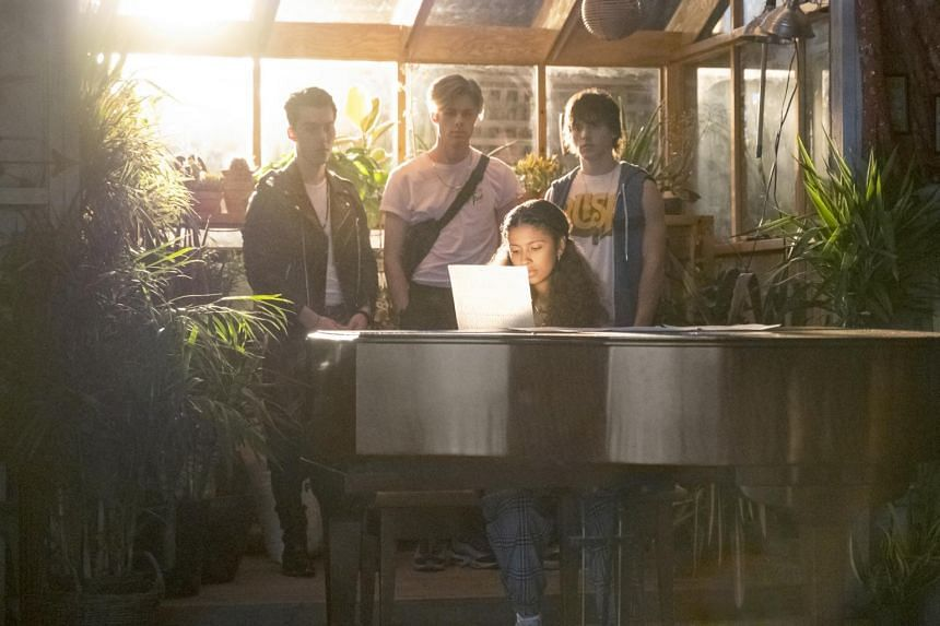 Julie And The Phantoms is about a girl, Julie (Madison Reyes) who rediscovers her love for music aided by three musically inclined ghosts, played by (from left) Jeremy Shada, Owen Joyner and Charlie Gillespie.