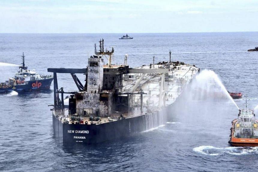 Fire-stricken oil tanker pushed away from Sri Lankan coast