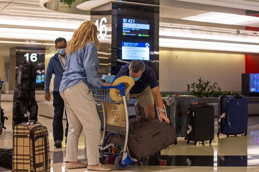 Passengers collecting their luggage after arriving in Singapore on Sept 8, 2020.