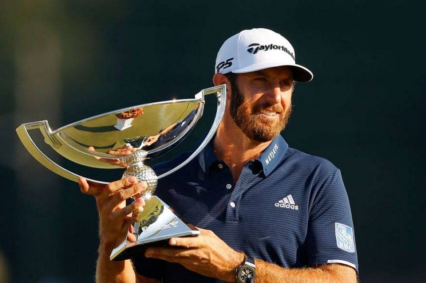 Dustin Johnson celebrates with the FedEx Cup Trophy after winning in the final round of the Tour Championship at East Lake Golf Club on Sept 7, 2020.